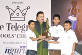 Hon'ble Sports Minister giving away the Best School Trophy to South Point School Players